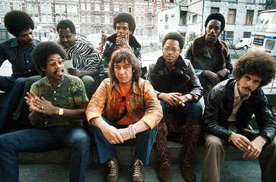Eric Burdon and War: front - Jordan, Burdon, Dickerson, Oskar. back - Miller, Allen, Brown, Scott