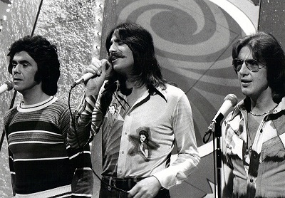 Three Dog Night vocalists on a 1975 NBC TV show: Danny Hutton, Chuck Negron, and Cory Wells.