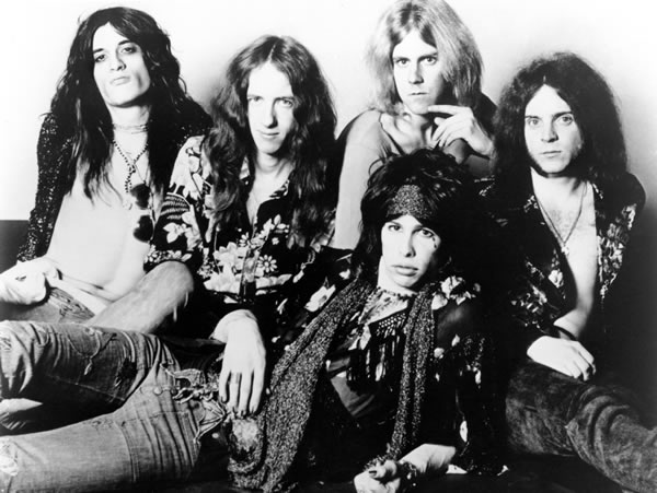 Raunchy boys in the '70s: Perry, Whitford, Tyler (reclining), Hamilton, and Kramer.